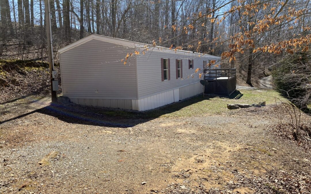 S/W Mobile Home & 0.91+-Acres