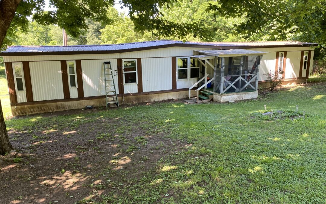 S/W Mobile Home & 0.65+-Acres