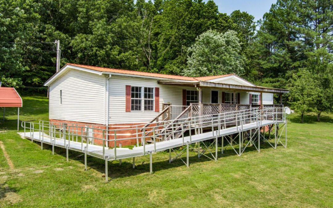 D/W Mobile Home & 5.0+/- Acres • Barn